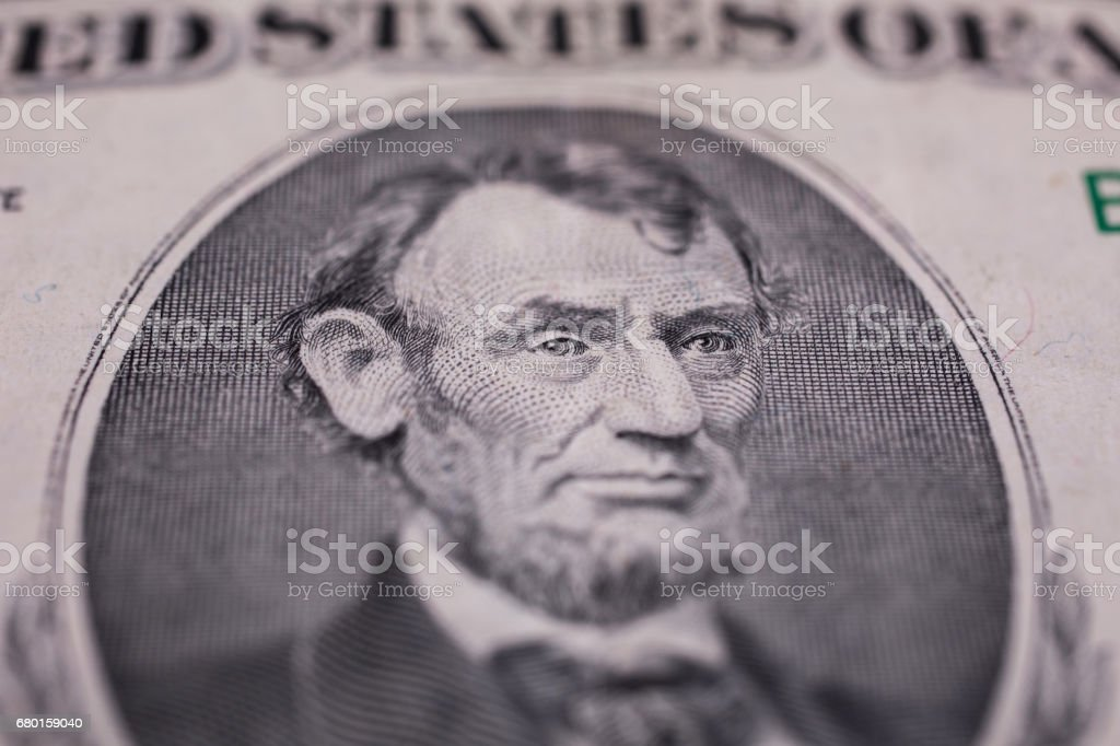 background of the money, five dollar bills front side. background of dollars, close up, President Abraham Lincoln on the dollar bill stock photo