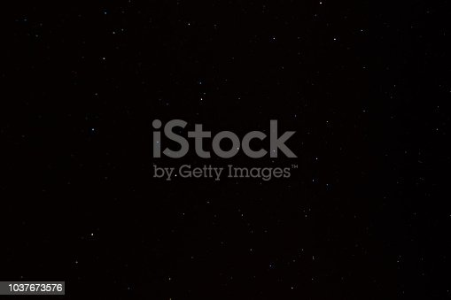 istock Background of the night sky with many stars 1037673576