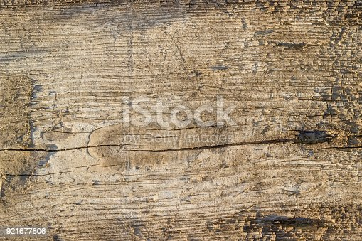 istock Background of the old dark cracked wooden plank 921677806