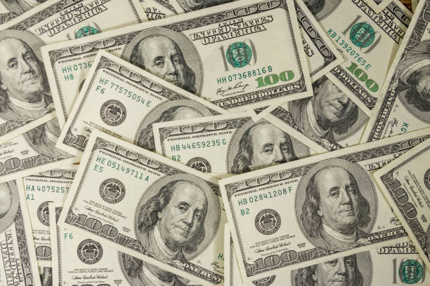background of the one hundred dollars bills - dollar bill stock pictures, royalty-free photos & images