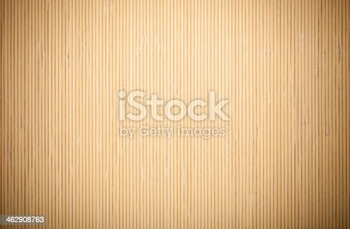 istock Background of vertical tan bamboo pattern 462908763