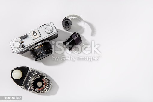 Background of vintage photo camera. Rangefinder film camera. Gray background. Copy space