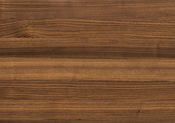 background of walnut wood surface - walnut stock photos and pictures