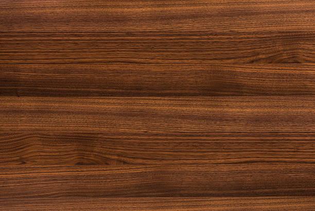 hintergrund des walnut wood oberfläche - walnussholz stock-fotos und bilder