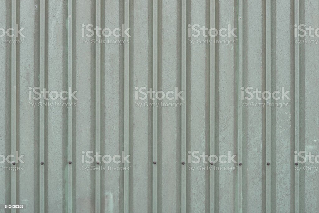 Background of weathered dark green metal wall panels stock photo