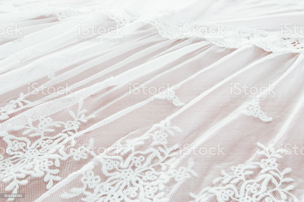Background of white delicate lace fabric. stock photo