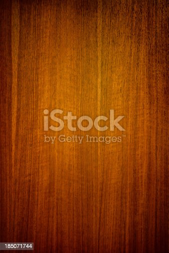 A rich background of wooden veneer panels, perfect for design backgrounds and overlays.  Vertical with copy space.