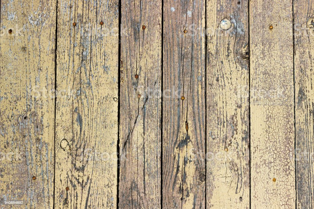 Background Of Wooden Boards With A Cracked Mustard Color
