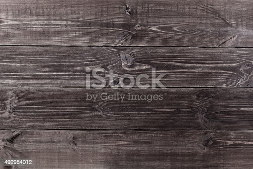 istock Background of wooden planks black color. 492984012