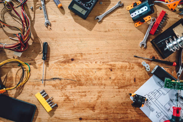 Background of wooden table with electrical tools Aerial view of electrical tools on wooden table with copy space soldering iron stock pictures, royalty-free photos & images