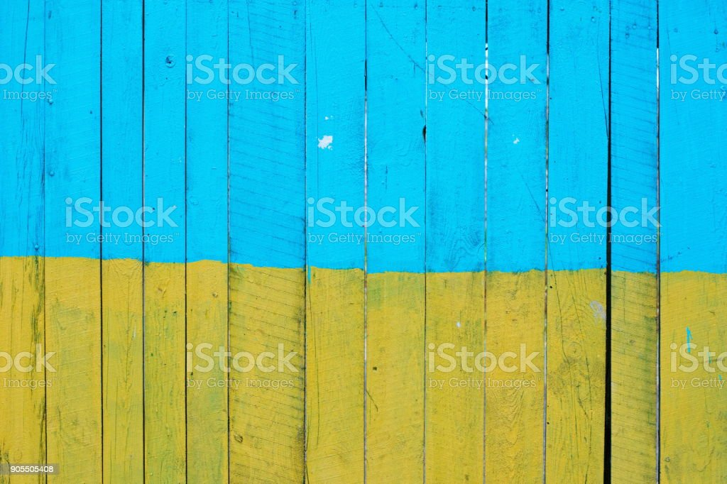 Background of yellow and blue painted wooden boards, painted in colors of Ukrainian national flag stock photo