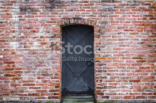 istock background old brick wall and wrought iron door 667569098
