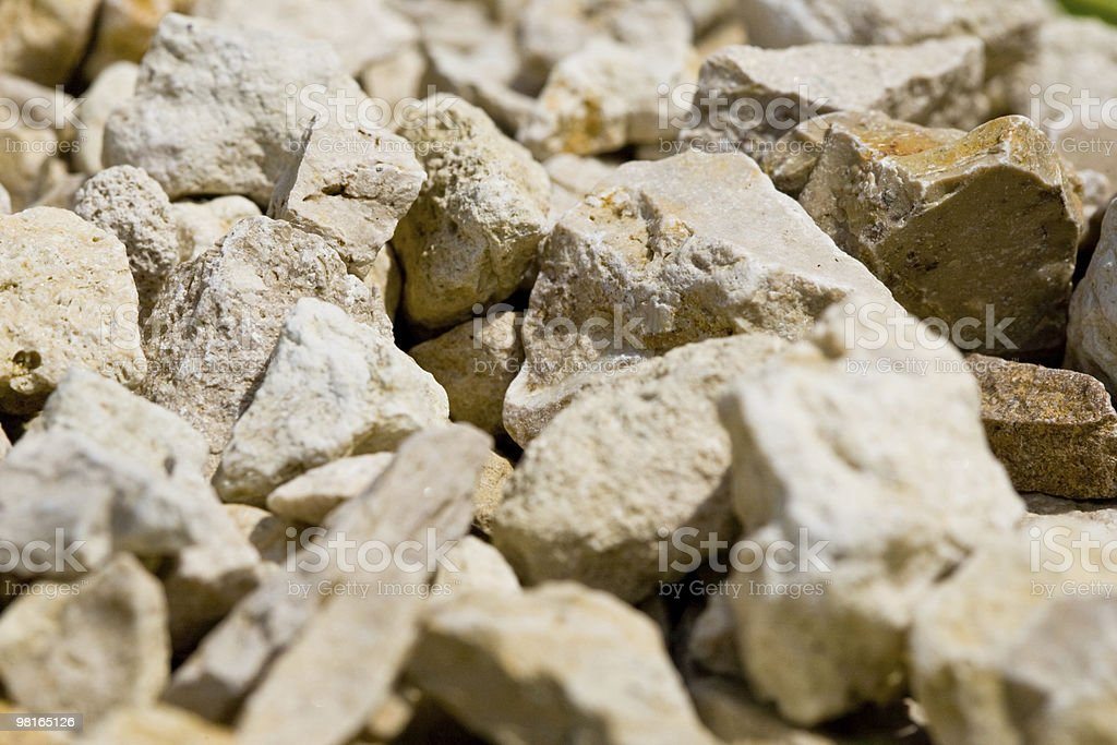 Background on beige stones in daylight royalty-free stock photo