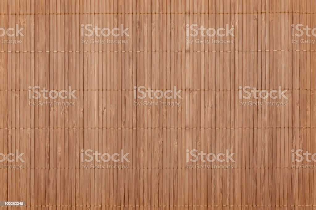 Background on the whole image of the bamboo mat light color. Horizontally located. royalty-free stock photo
