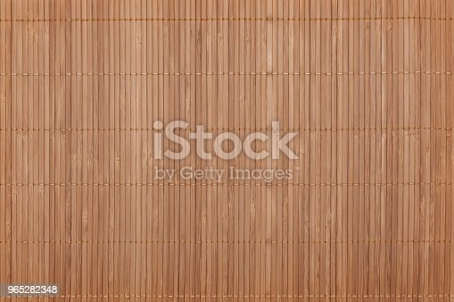 istock Background on the whole image of the bamboo mat light color. Horizontally located. 965282348