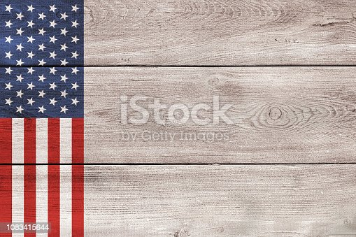 USA flag elements on black and white wood planks backdrop. Color effects and management made with Photoshop.