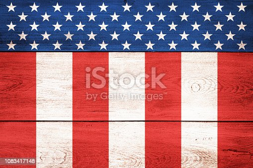 USA flag elements on wood planks backdrop. Color effects and management made with Photoshop.