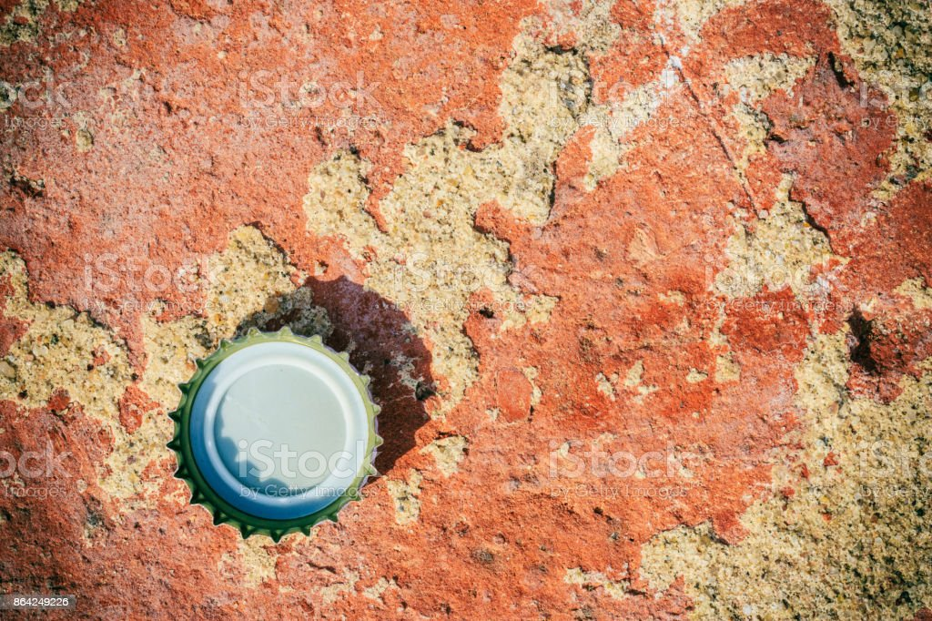 Background or texture of red brick and bottle cap. royalty-free stock photo