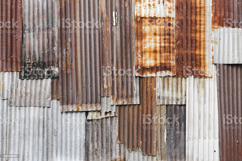 Background pattern comprised of rusted corrugated metal panels royalty-free stock photo