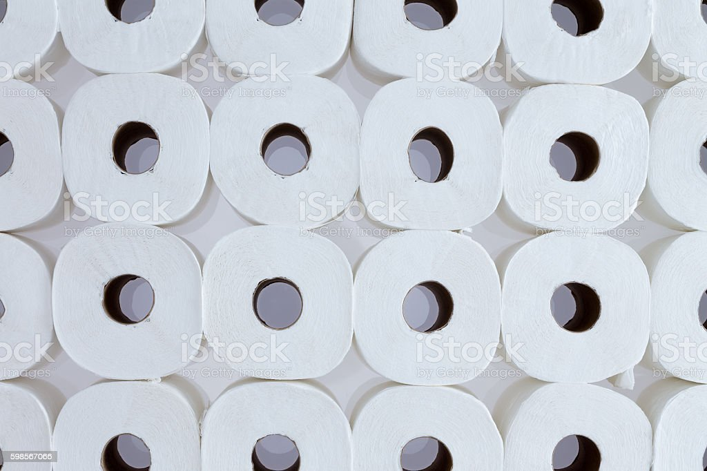 Background pattern of white toilet paper rolls stock photo