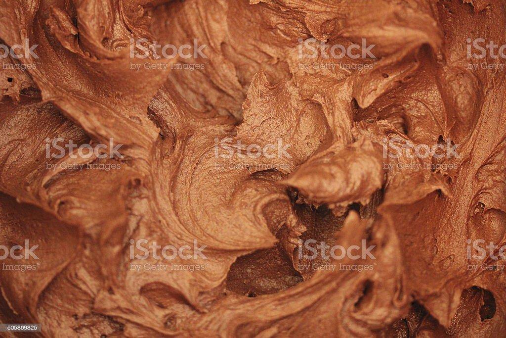 Background photo of delicious whipped swirled sweet chocolate cream stock photo