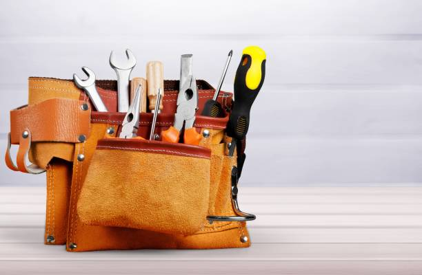 Background. Tool belt with tools on desk repairman stock pictures, royalty-free photos & images