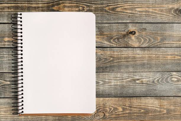 Background. Spiral notebook with blank page on wooden table note pad stock pictures, royalty-free photos & images