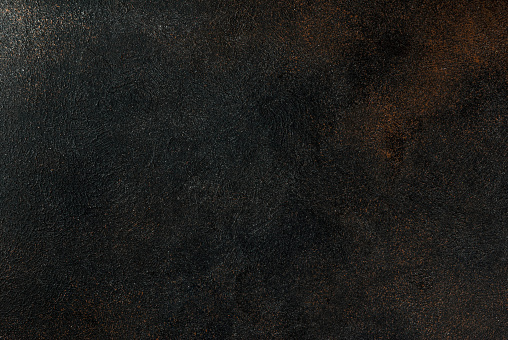 Old dark rusty background copy space top view