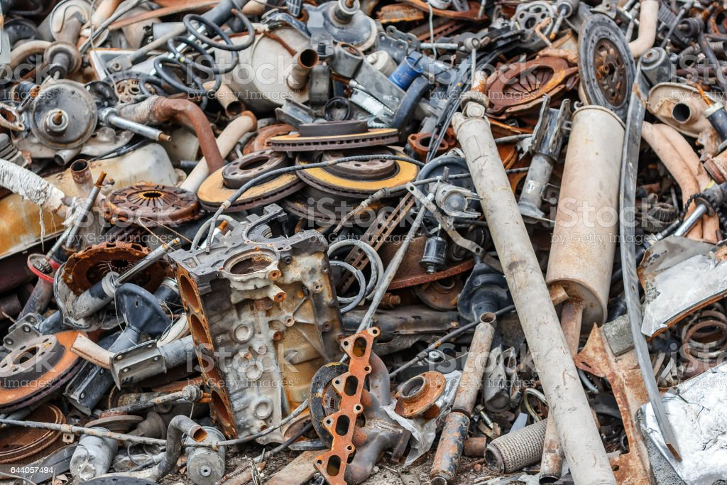 Background pile of rusted metal scrap on the open air. stock photo