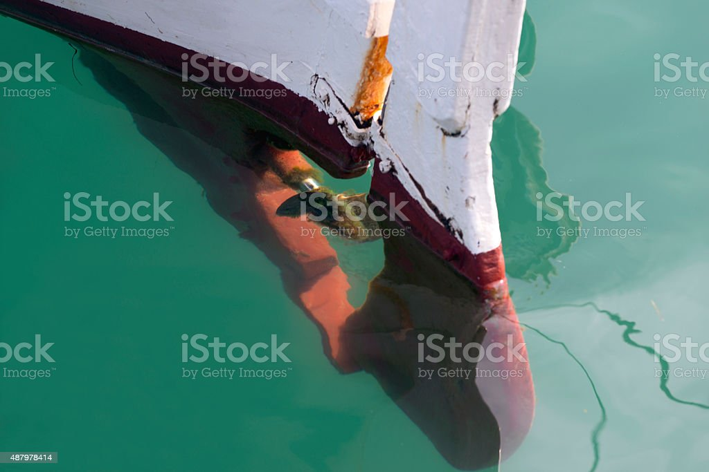 Background: reflection in a sea of fishing boat details stock photo