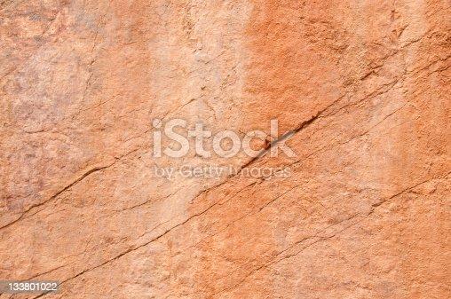 Background: salmon colour limestone.