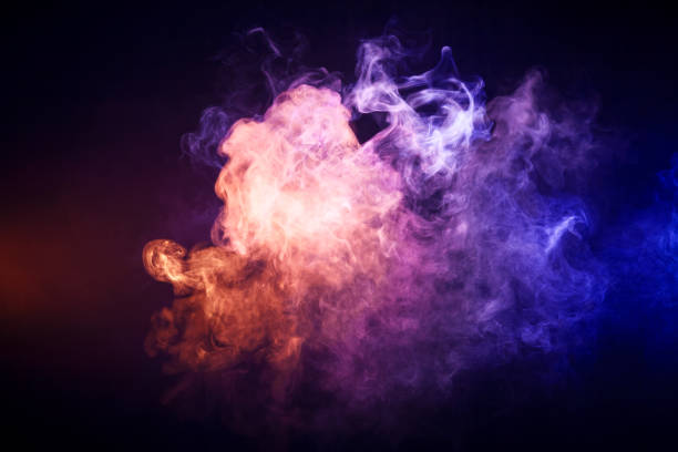 Background   smoke of vape Background from yellow and  blue  smoke of vape on black isolated smoke stock pictures, royalty-free photos & images