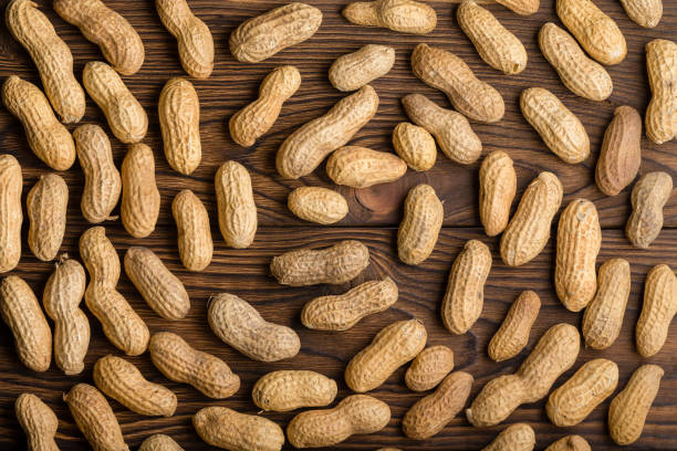 Background spiral pattern of circling peanuts stock photo
