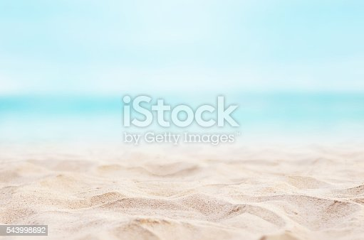 Close up sand with blurred sea sky background, summer day