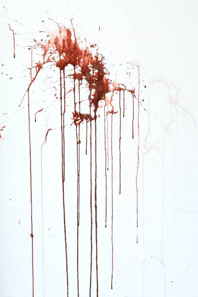 Background texture cement white wall with red blood-like paint streaks stock photo