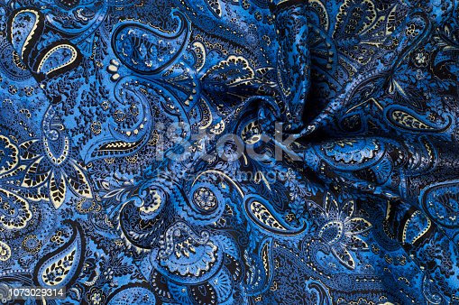istock Background texture, Fabric blue paisley. Designed for Fabri-Quilt, this soft double napped  flannel is perfect for quilting, apparel, and home decor accents. Colors include black, blue, and white. 1073029314