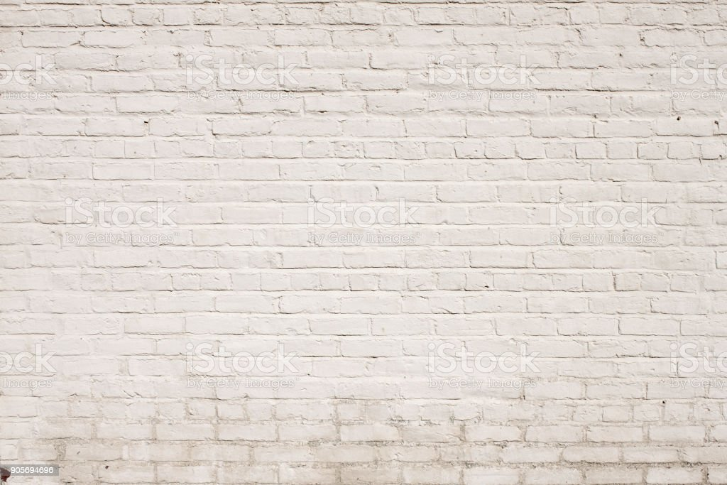 background texture of a Brick Exterior Wall Painted White stock photo