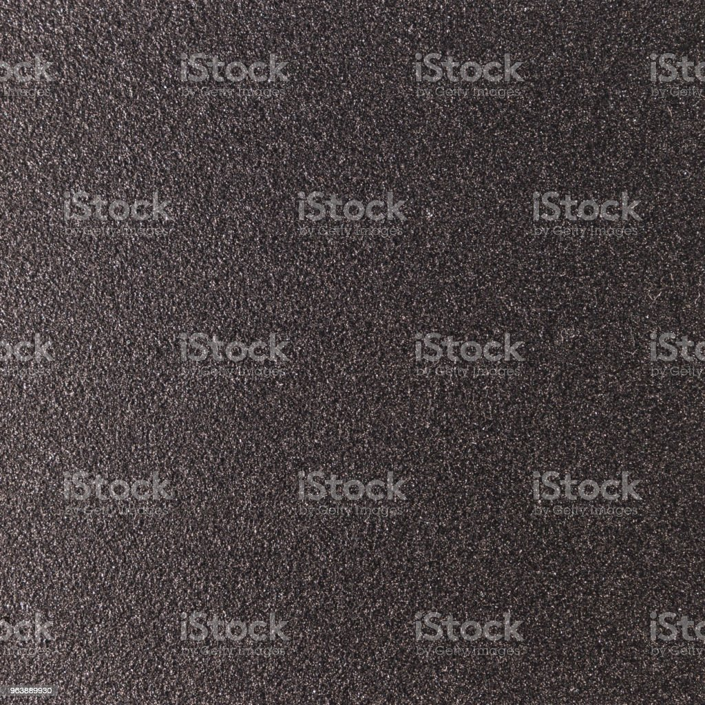 Background texture of a shiny metal sheet with a rough stippled textured surface reflecting light. Metal texture - Royalty-free Abstract Stock Photo