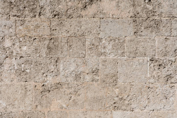 Background texture of a stone wall brown tones stock photo