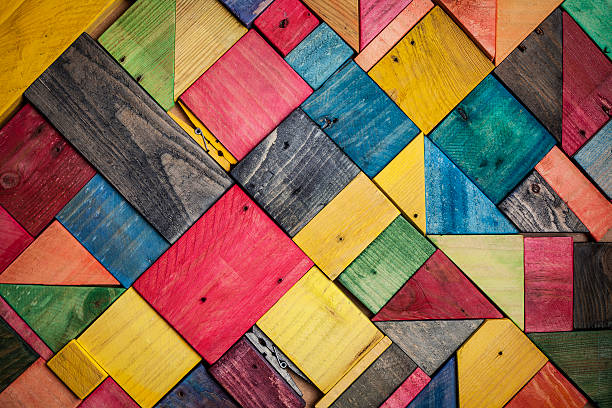 background texture of colored wood pieces stock photo