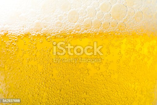 Background  texture of frosty beer with foam and bubbles