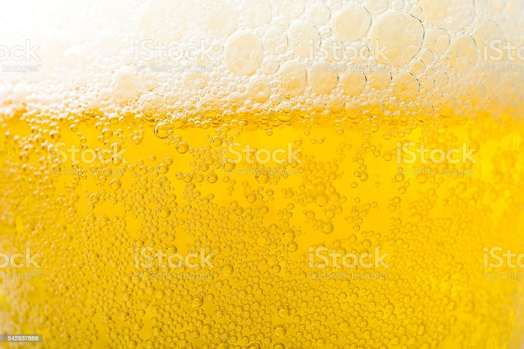 Background  texture of frosty beer with foam and bubbles stock photo