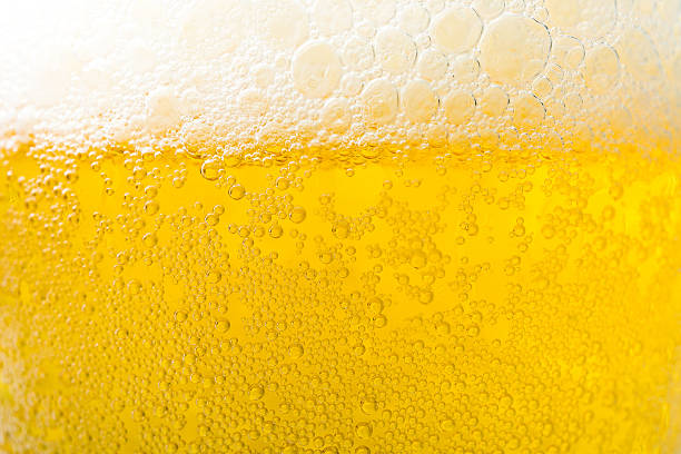 background  texture of frosty beer with foam and bubbles - beer foam stock photos and pictures