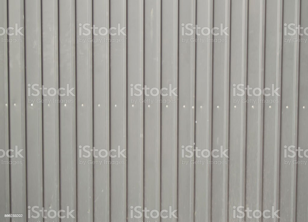 background texture of gray metal siding to finish the outside stock photo