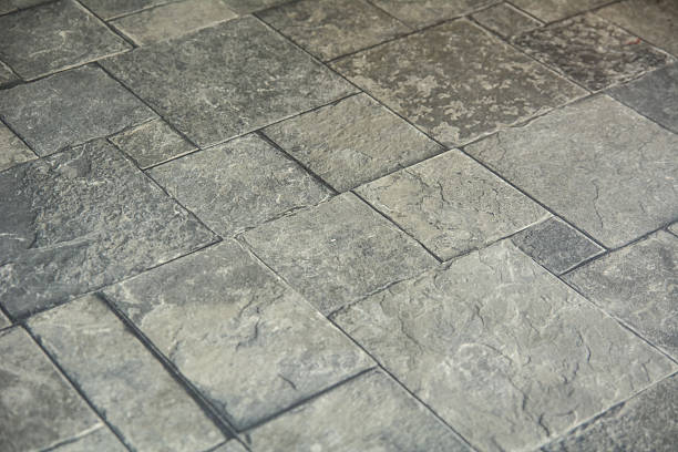 Background texture of gray tiled pavement city ground stock photo