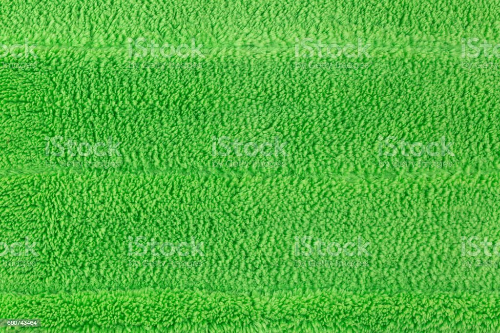 Background texture of new clean green microfiber mop floor stock photo