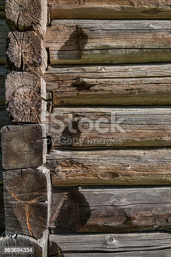 1124475954 istock photo Background texture of old wooden planks logs bark 863694334