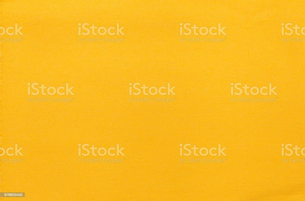Background texture of yellow fabric jeans stock photo