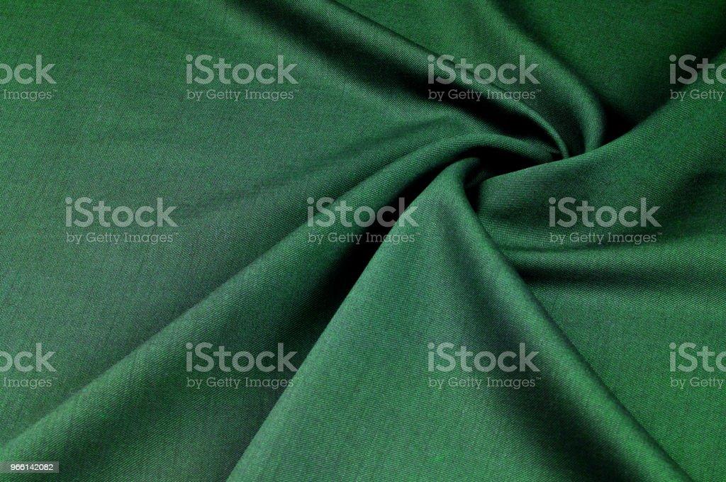 Bakgrundsstruktur, mönster. tyg ull flanell grön. Inspirerad av antika yttre tvättlappar, detta tyg har en stark utseende, balanseras av en känsla av supercompatibility. - Royaltyfri Abstrakt Bildbanksbilder