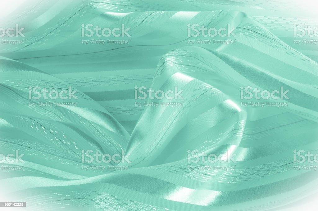 Achtergrondstructuur, patroon. Groene zijde stof met een lichte streep. Groene doek. Soepele elegante groene satijnen achtergrond. - Royalty-free Abstract Stockfoto